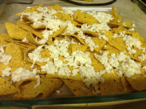 Sprinkle Cheese on Nachos and Pop in Oven