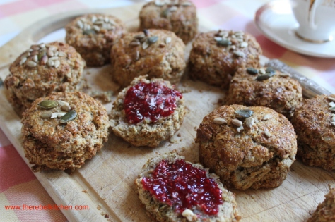 Brown Scones Slathered With Butter and Jam